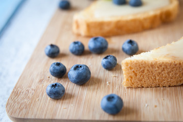 Blueberries close-up. Sandwiches with cream honey