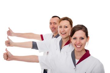 Pflegekräfte mit Daumen hoch, isoliert