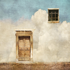 Obraz Surreal landscape with old door and window on cloudy sky - fototapety do salonu