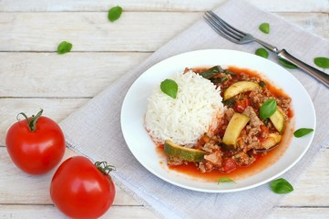 Spicy mincemeat with tomatoes, basil and zucchini with basmati rice