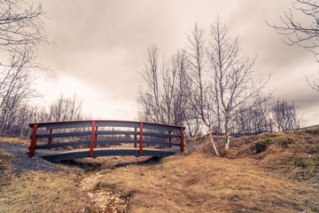 Bridge over an empty river stream