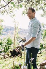 Happy man gardening at yard