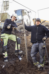 Portrait of confident construction workers at site