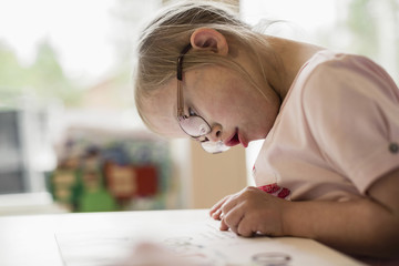 Girl  with Down syndrome reading