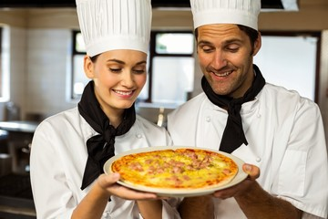 Two head chef presenting a pizza Wall mural