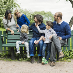 Homosexual families spending leisure time in park