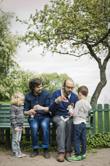 Full length of male homosexual family spending leisure time at park