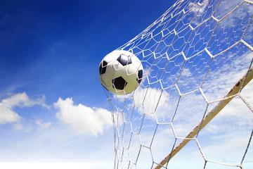 Fototapeta soccer ball in goal