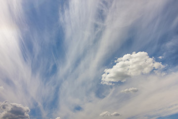 Dramatic blue sky with puffy white clouds in bright clear sunny