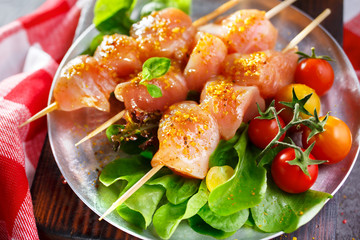 Raw chicken on wood skewers
