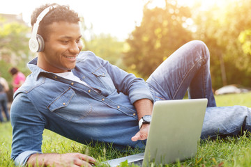 Attractive Arabian student is relaxing on lawn