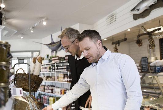 Businessmen selecting food at cafe