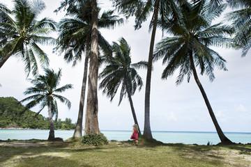 Thailand, girl on palm beach