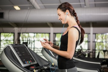 Woman listening to music on treadmill