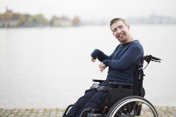 Portrait of smiling disabled man on wheelchair