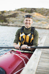 Portrait of happy man kayaking in river