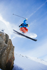 Low angle view of mid adult man skiing against sky