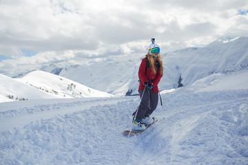 girl snowboarder rides a snowboard towed holding  rope.