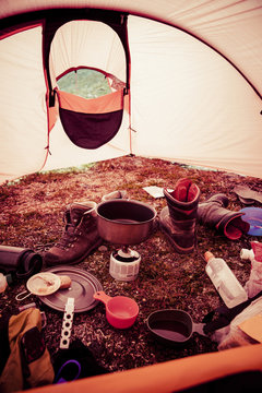 Messy tent in forest
