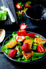green salad with strawberry and fried cheese