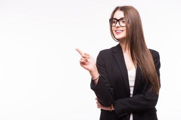 Young elegant business woman pointing invisible product at white background