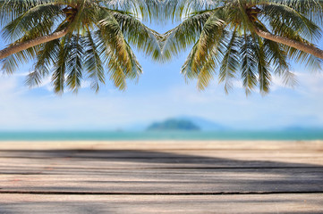 Coconut palm tree with plank on tropical beach background, happy summer holiday concept and display products idea