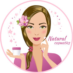 Beautiful brunette woman holds a cream (cosmetics)