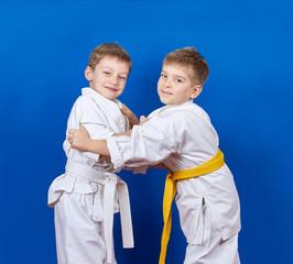 Two athletes train judo techniques