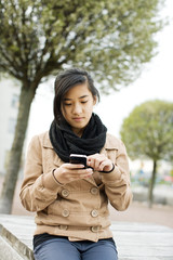 Teenage girl using smart phone