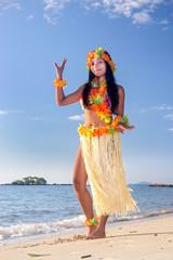 Hula Hawaii dancer dancing on the beach