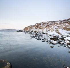 Snow covered rocks by sea, West Coast, Bohuslan, Sweden