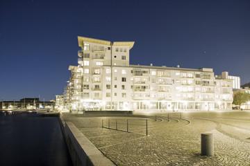 Illuminated apartment building at dusk