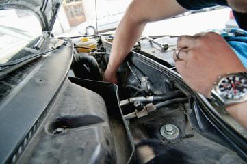 Close-up of a man repairing vehicle