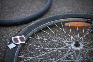 Patch and metal chip on damaged bicycle wheel
