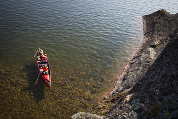 High angle view of a father with two children on canoe
