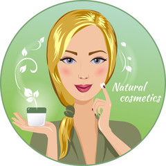 Beautiful blonde woman holds a cream (cosmetics)