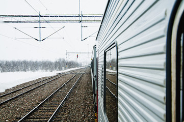 Train at snow in winter