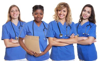 Gruppe vier sympathische Krankenschwestern