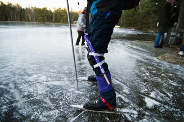 Long-distance skaters standing in bay