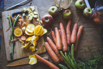 High angle view of carrots and apples with oranges on table