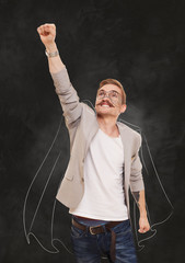 Man Superhero in flying pose at black background