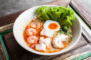 Tomyum noolde seafood and egg, Tomyum noodle, Thailand noodle, Thai food yummy