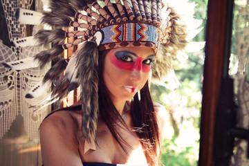 Beautiful woman wearing an Indian headdress
