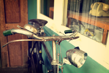 Vintage bicycle in cafe (coffee shop) - retro filter effect styles