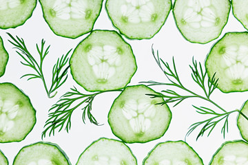 Cucumber slices. Green dill. Pattern. Food background. Macro. Texture.