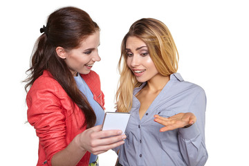 Two women friends taking selfie with smartphone.