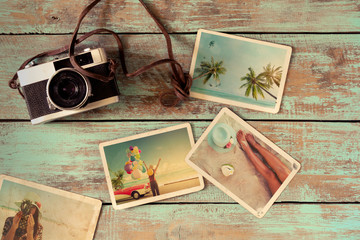 Summer photo album of journey honeymoon trip on wood table. instant photo of vintage camera - vintage and retro style