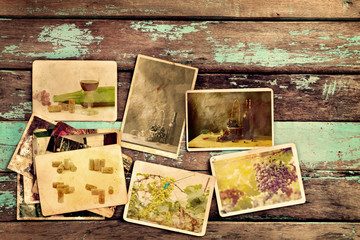 Photo album of wine on old wood table. instant photo of vintage camera - vintage and retro style