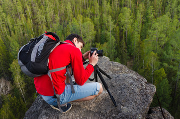 photographer take pictures of a rock