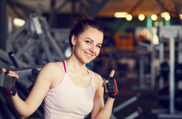Young smiling happy woman in a fitness center